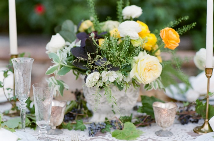 Wedding centerpiece with yellow, white and green blooms
