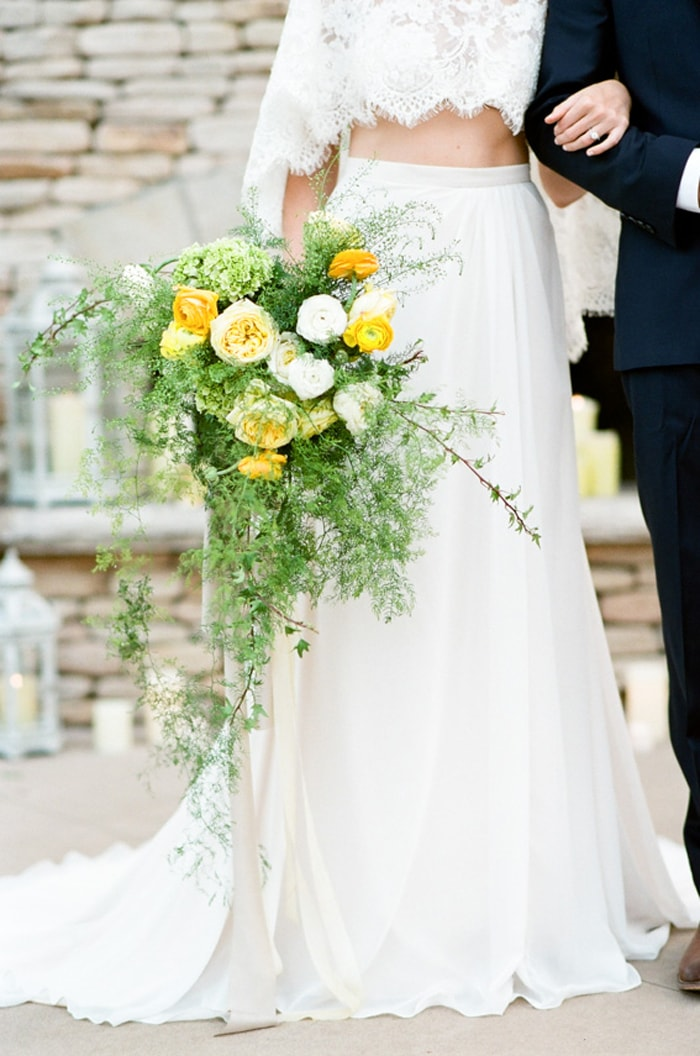 Closeup of a wedding bouquet adorned with yellow, white and green blooms