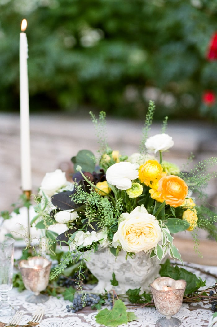 Wedding centerpiece with white, yellow and green blooms