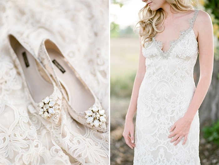 Closeup of 2-carat engagement ring on top of lace wedding gown