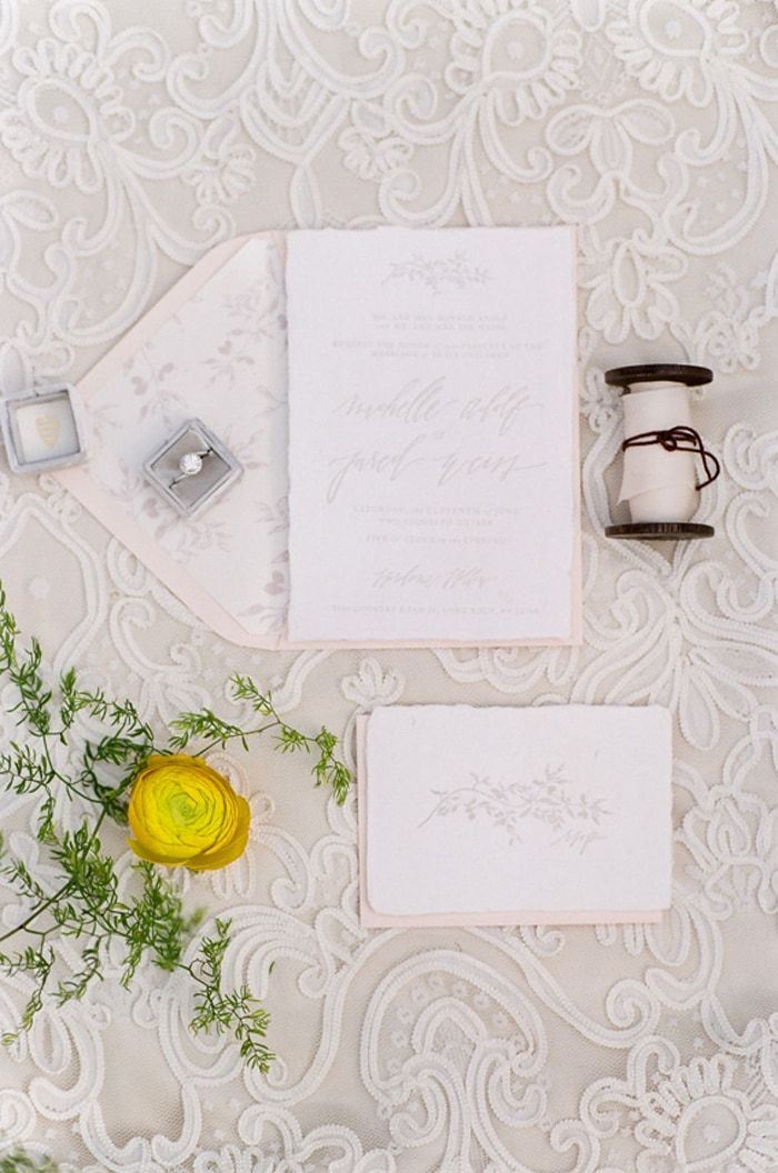 Closeup of wedding invitation with hand calligraphy