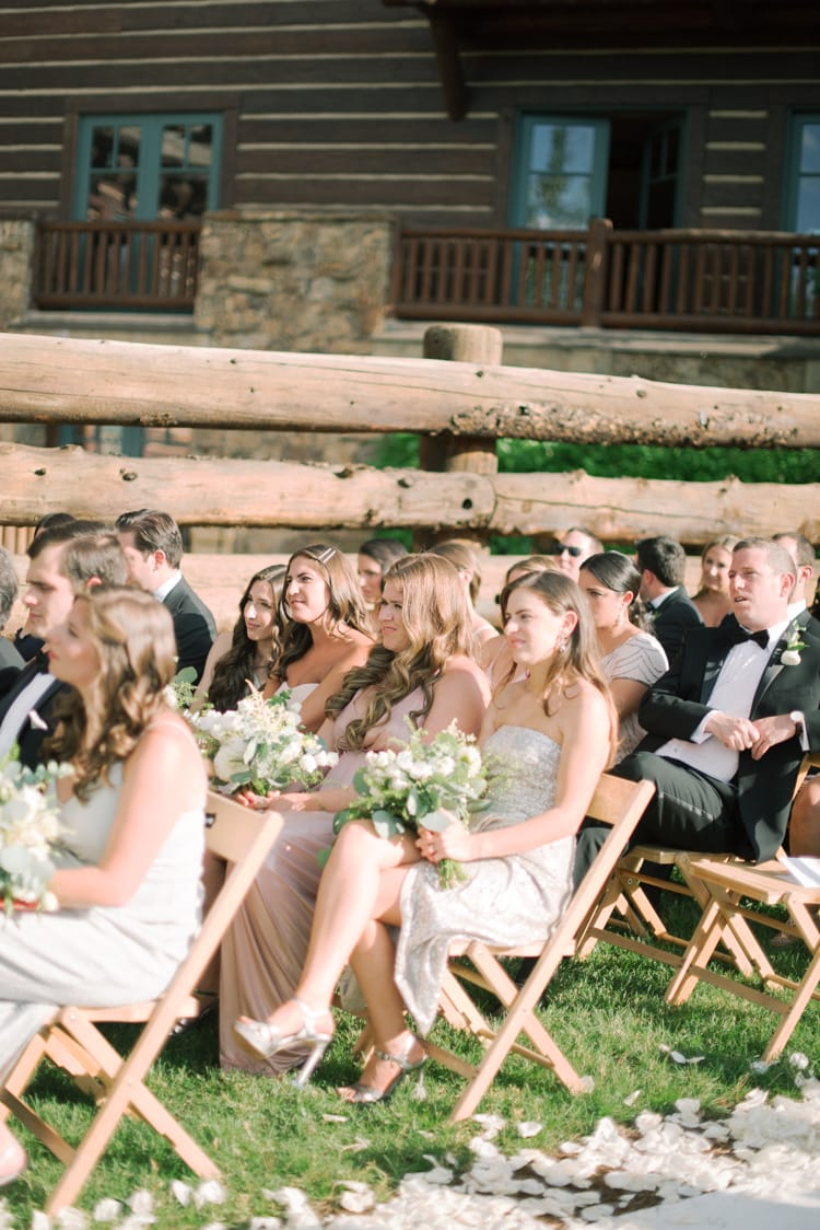 Wedding guests sitting during a wedding ceremony and watching bride and groom getting married in Colorado
