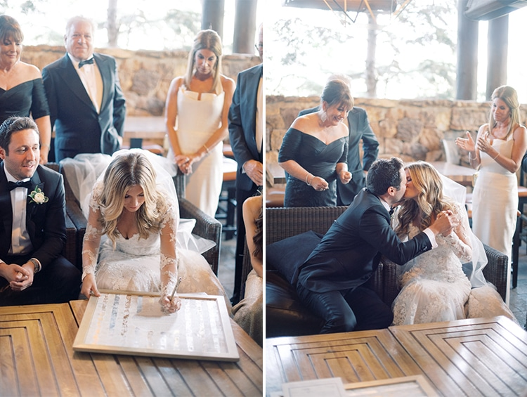Bride and groom signing their Ketubah on their Colorado wedding day