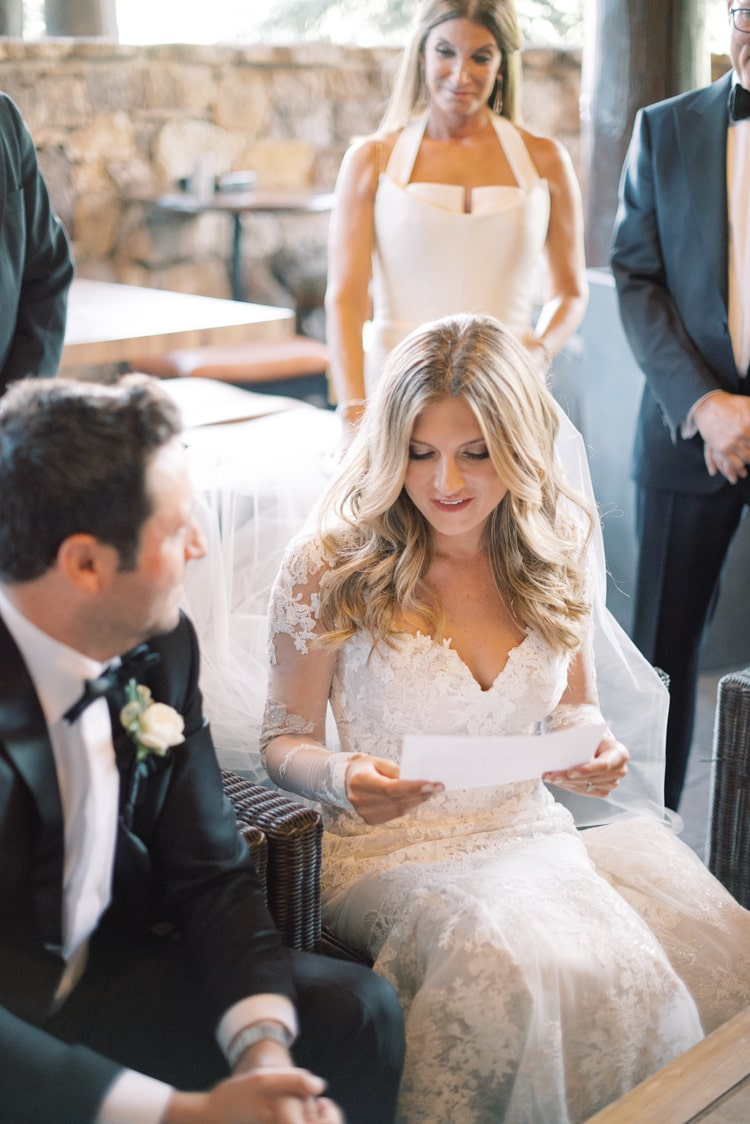 Bride and groom reading their vows out loud before signing the Ketubah at the Ritz Carlton Bachelor Gulch