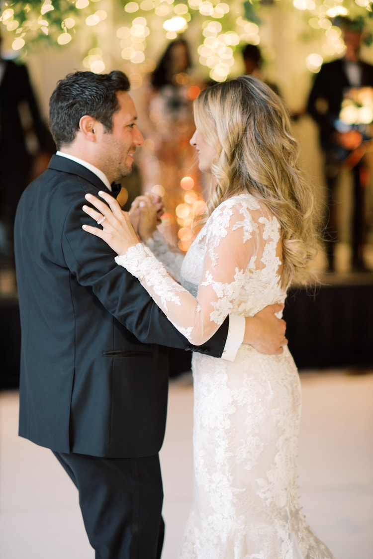 Bride and groom embracing each other during their first dance at the Ritz