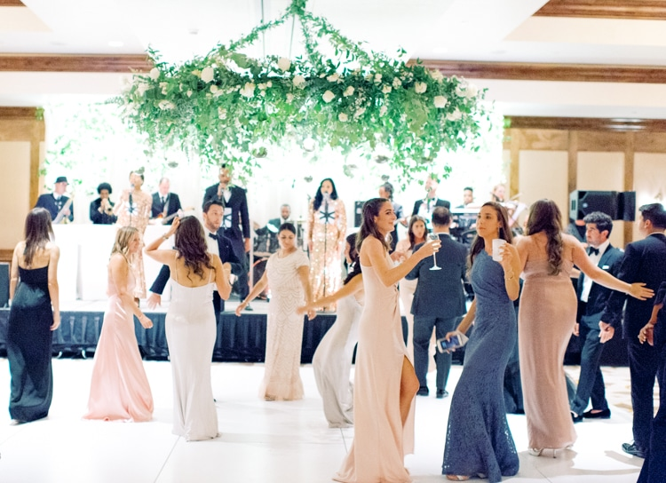 Wedding guests dancing on the dance floor at the Ritz Carlton Bachelor Gulch in Colorado
