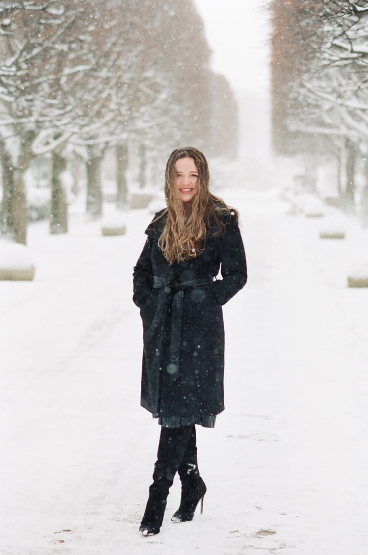 Bride to be at her Chicago engagement session standing in snow
