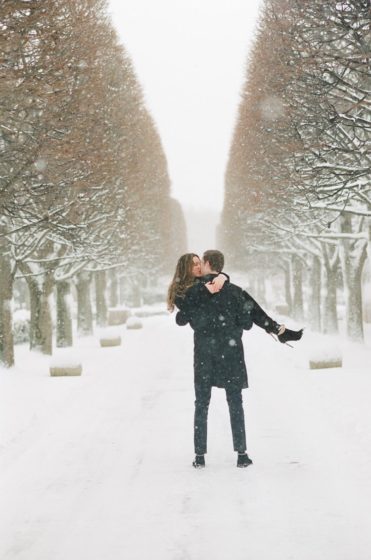 Groom lifting his bride during their Chicago winter engagement session
