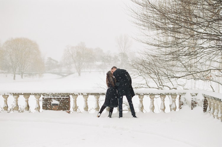 Engaged couple kissing each other during their snow engagement session in Chicago
