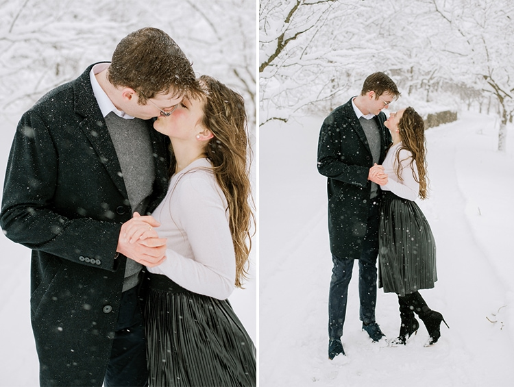 Engaged couple dancing in snow during their Chicago winter engagement