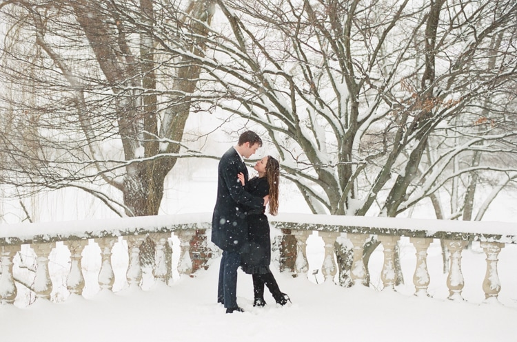 Engaged couple embracing each other at the Chicago Botanic Garden covered in snow