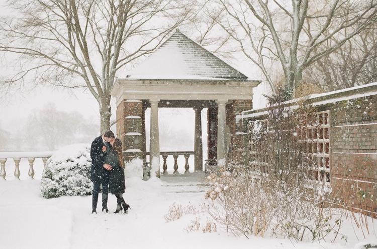 Bride and groom kissing each other during their snow engagement session in Chicago