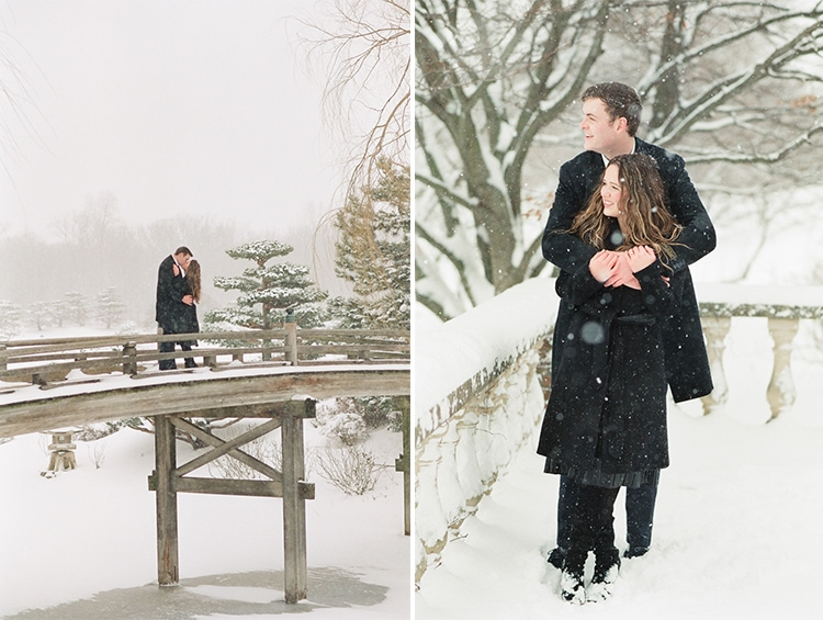 Engaged couple standing on top of the Japanese Garden bridge covered in snow