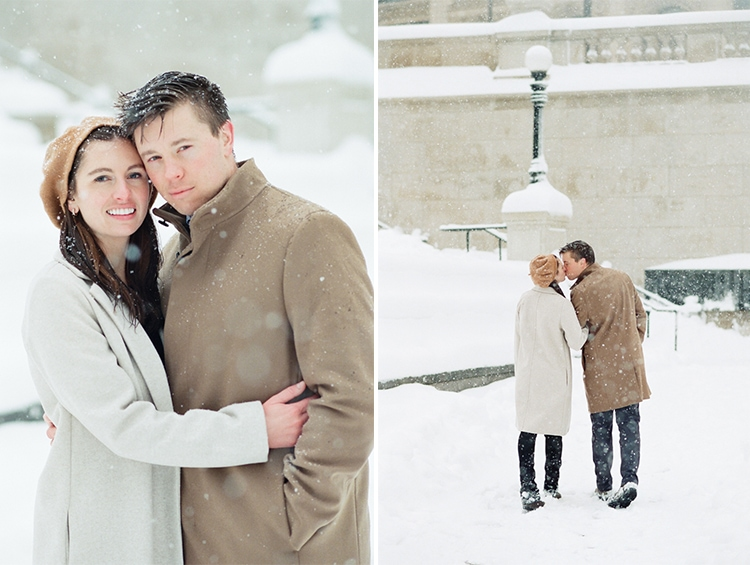 Engaged couple kissing each other during a walk at the Chicago Riverwalk in snow