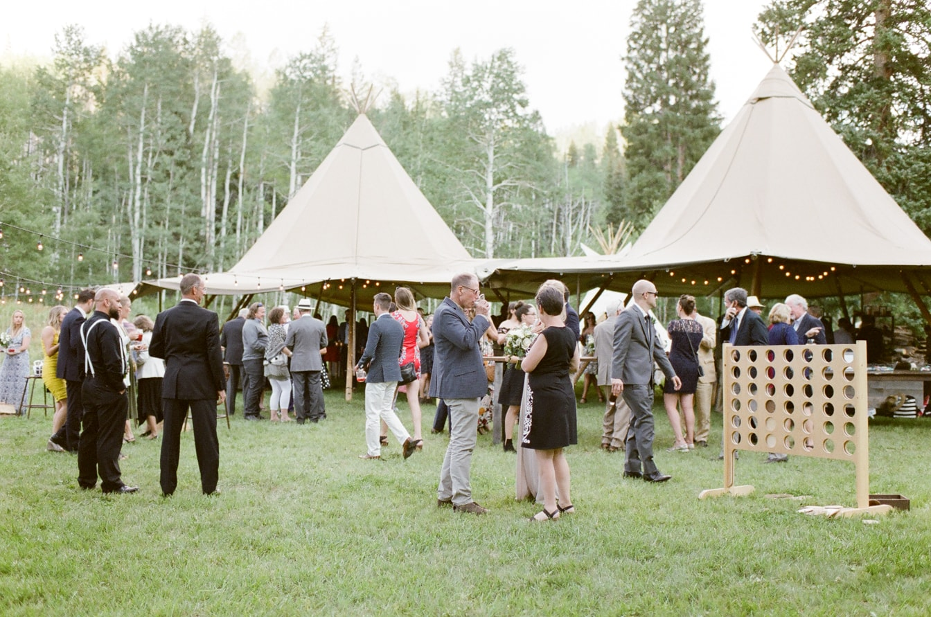 Wedding guests in front of teepee