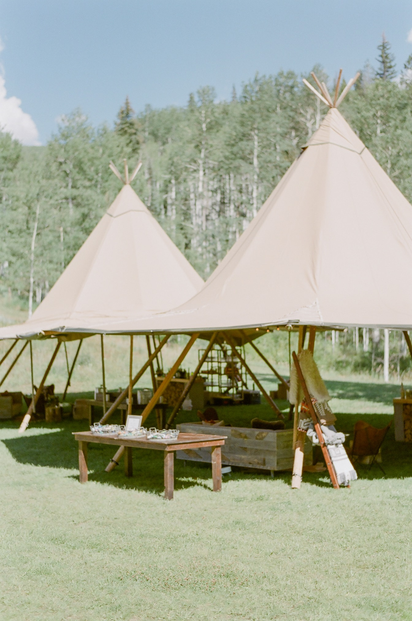 Modern teepee lounge area at an outdoor wedding cocktail reception in Vail Colorado