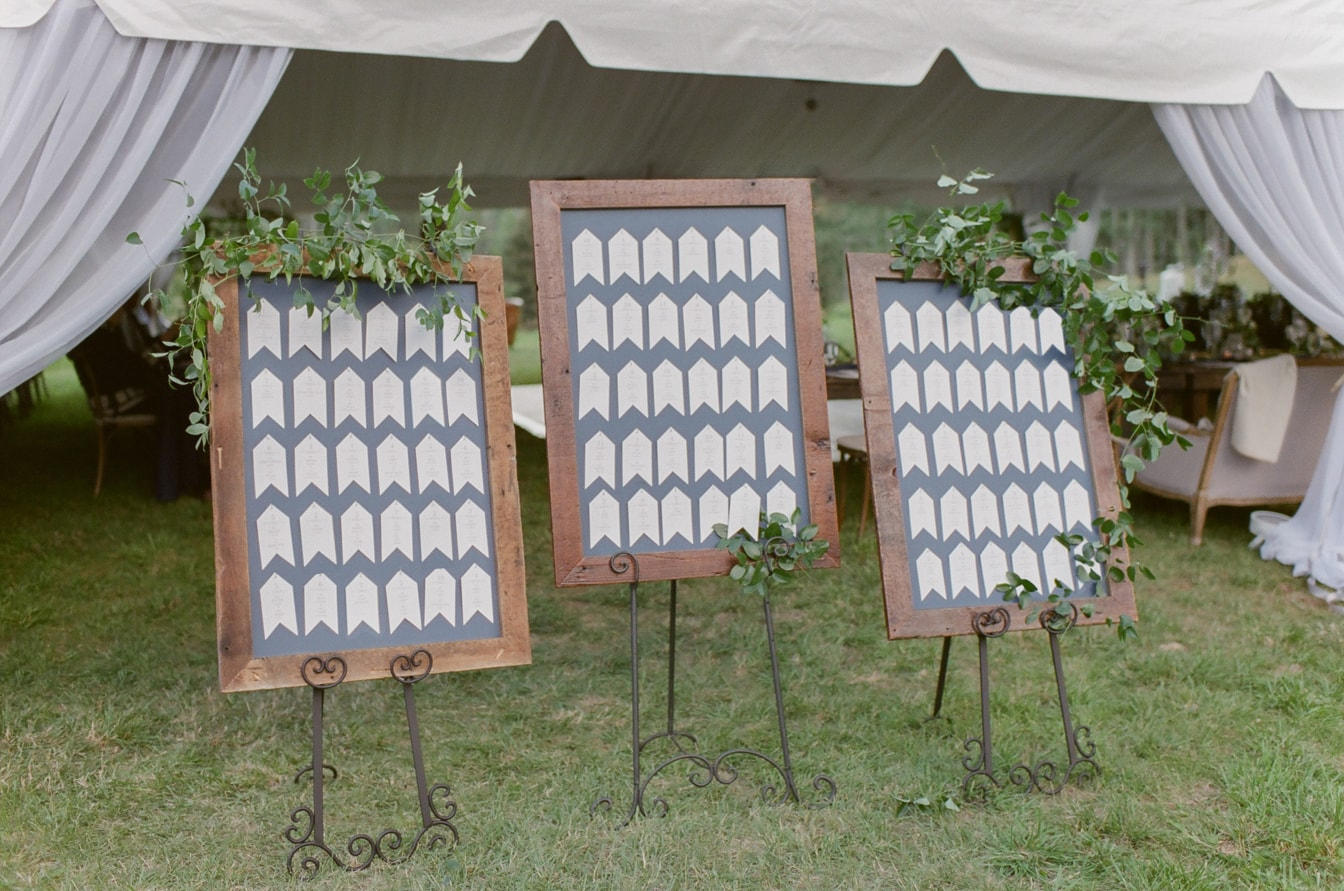 Name card boards in blue embellished with florals