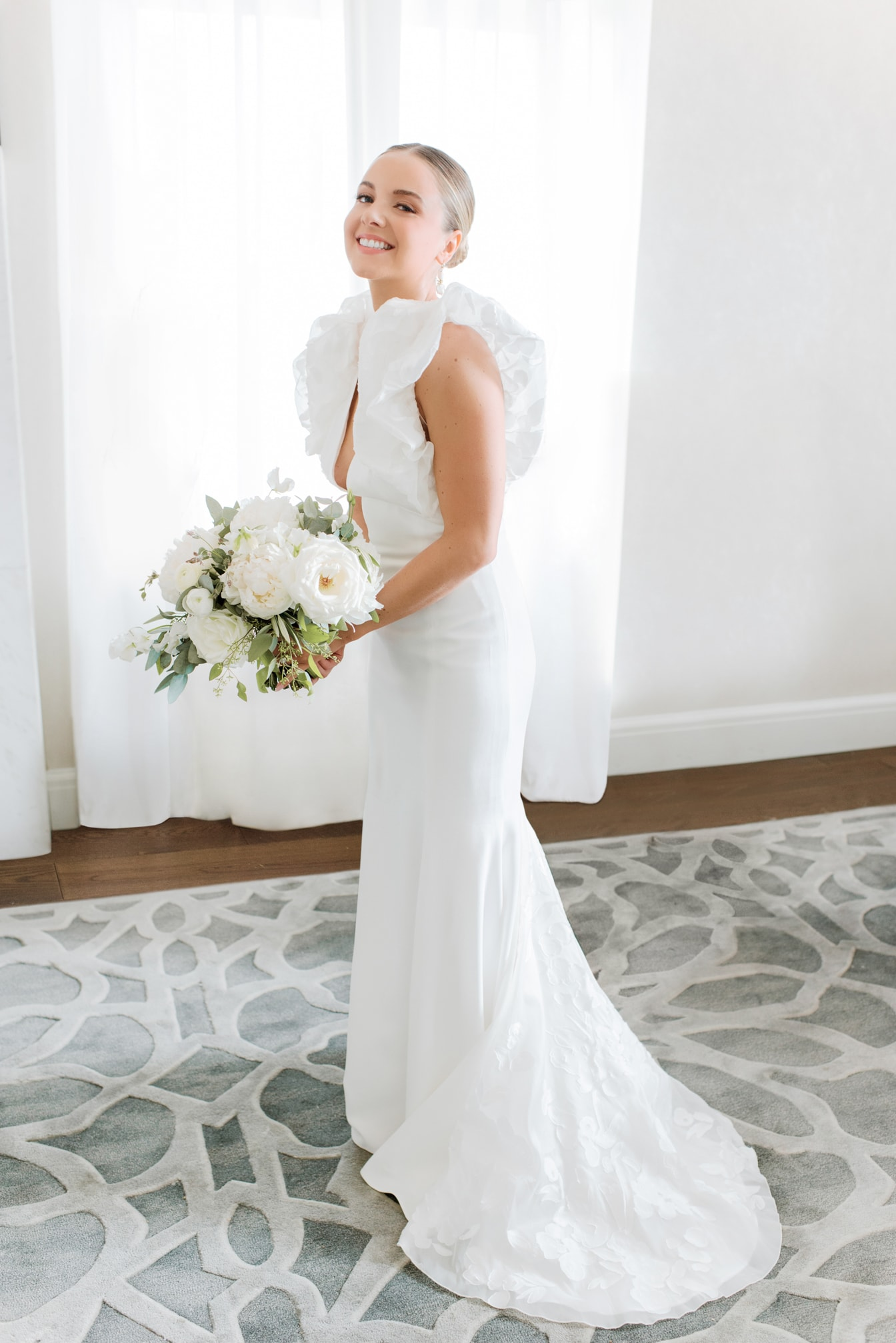 Chicago modern bride getting ready and smiling with her bouquet