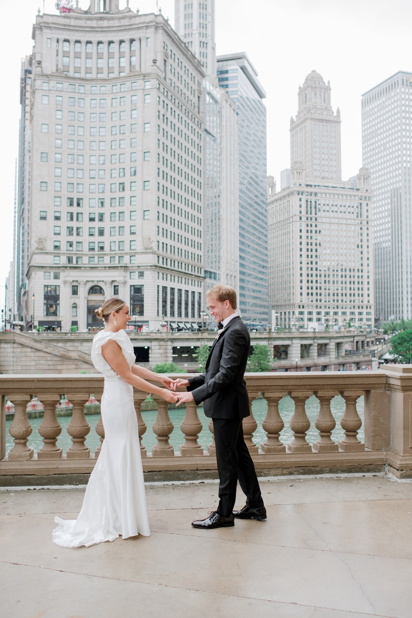 First look of Chicago bride and groom at Wrigley Building
