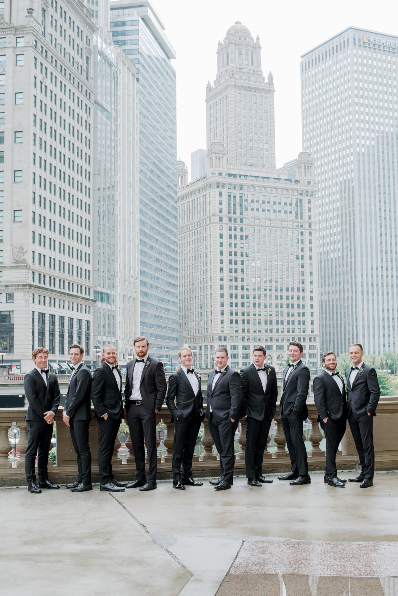 Groom with groomsmen at Wrigley Building in Chicago
