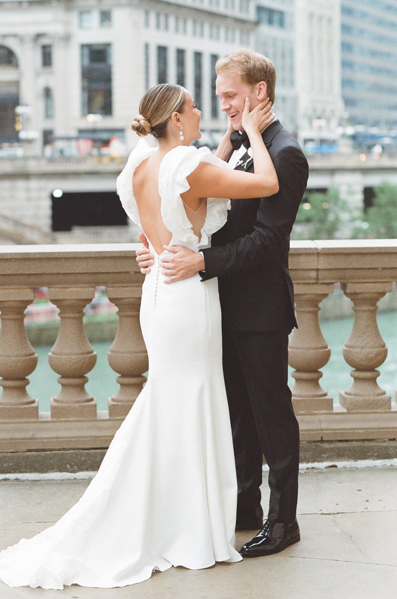 Bride and groom embracing each other at their first look