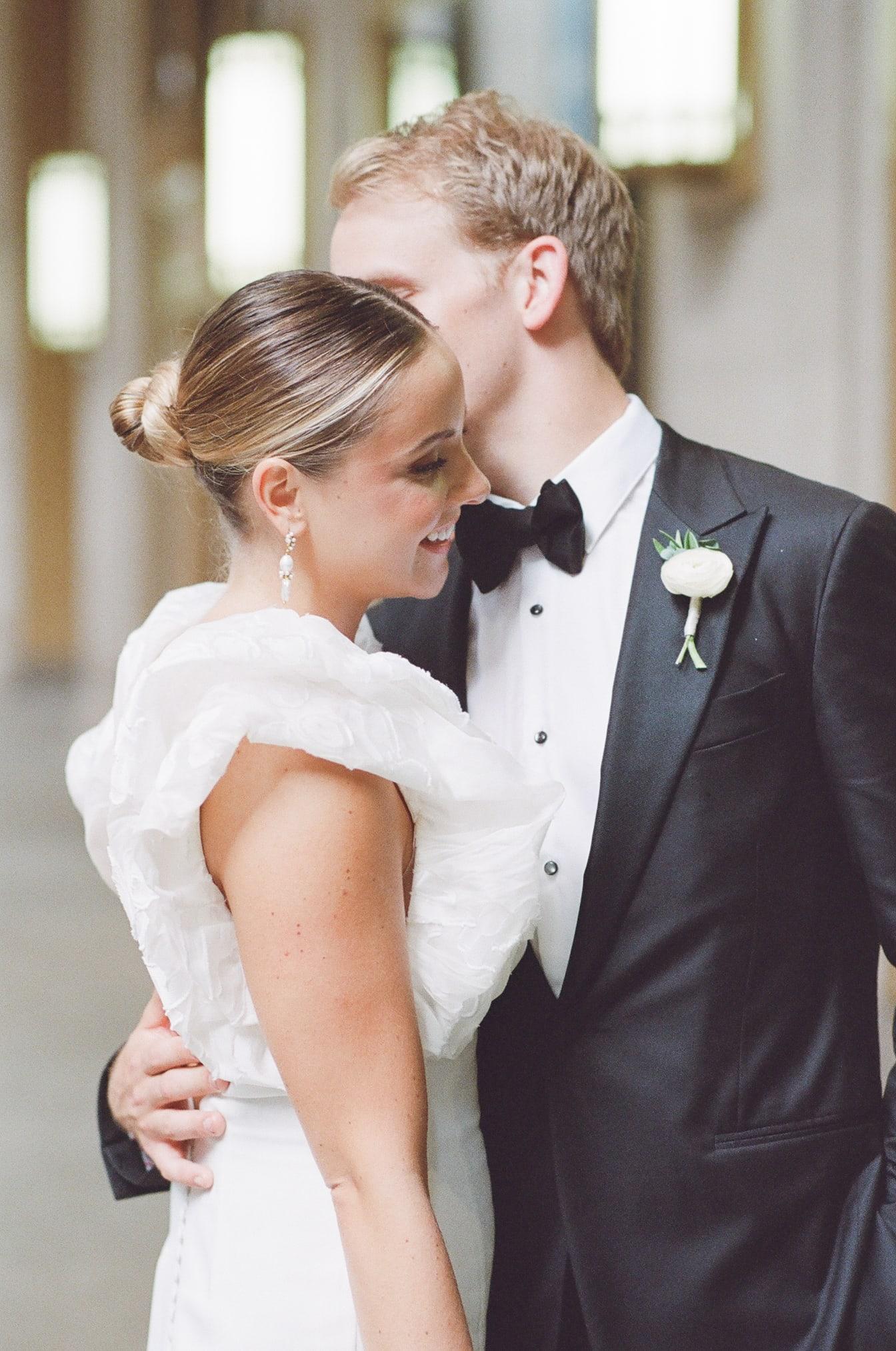 Groom kissing his bride at Lyric Opera House