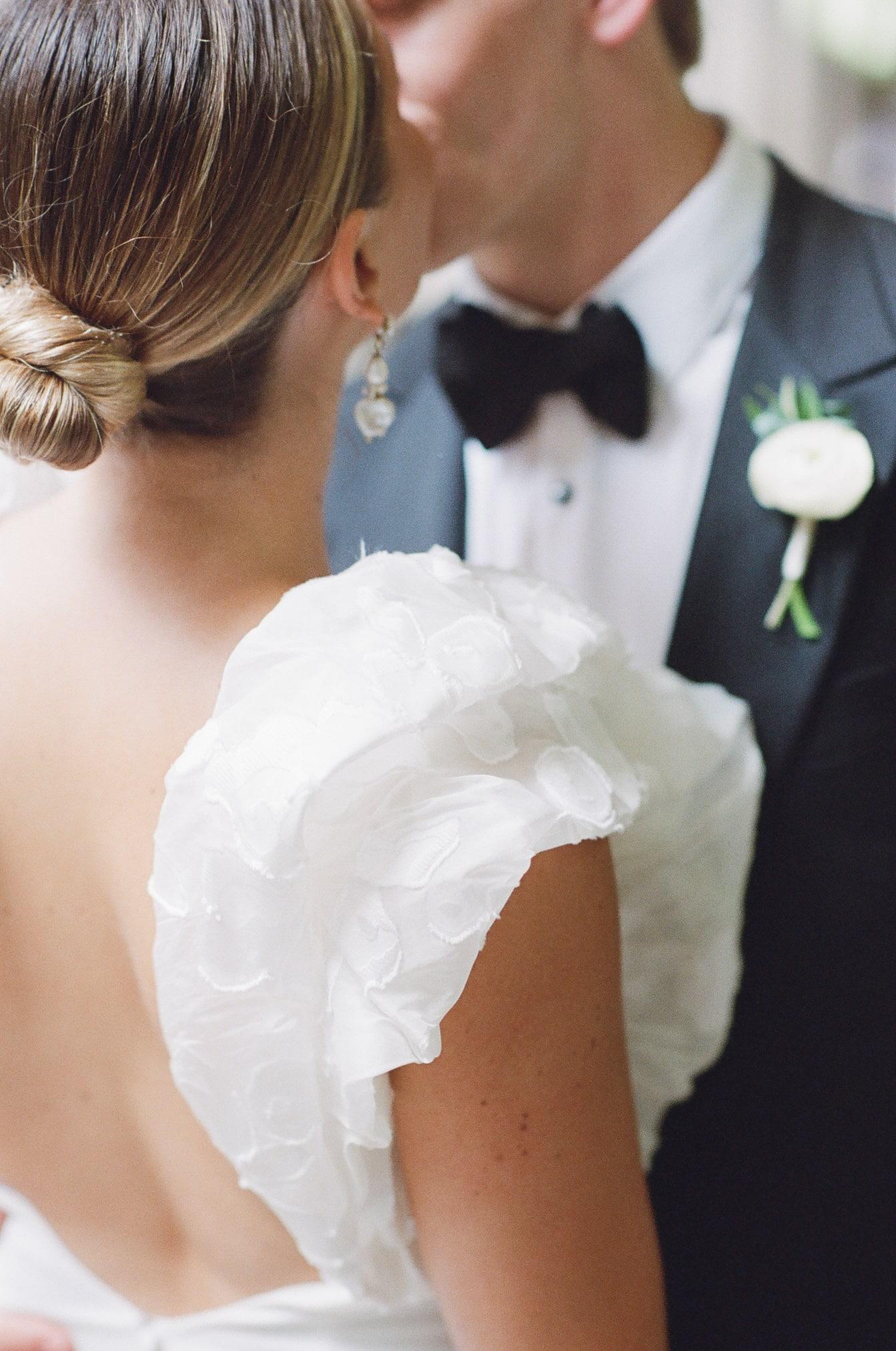 Closeup of wedding gown sleeve of designer Rime Arodaky