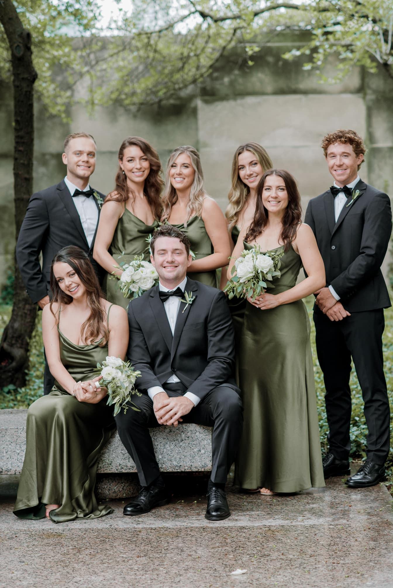 Wedding Party sitting at Chicago Art Institute Garden