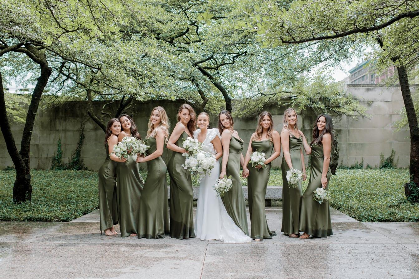 Bride with her bridesmaids smiling at Chicago Art Institute Garden