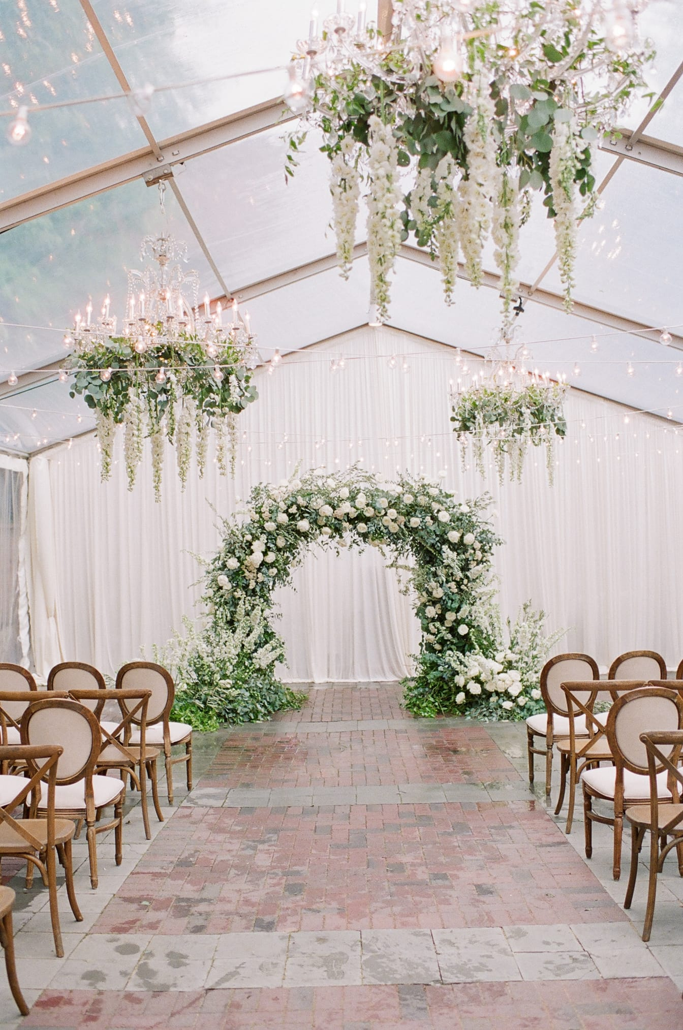 Floral wedding arch with white and green flowers at Chicago Illuminating Company