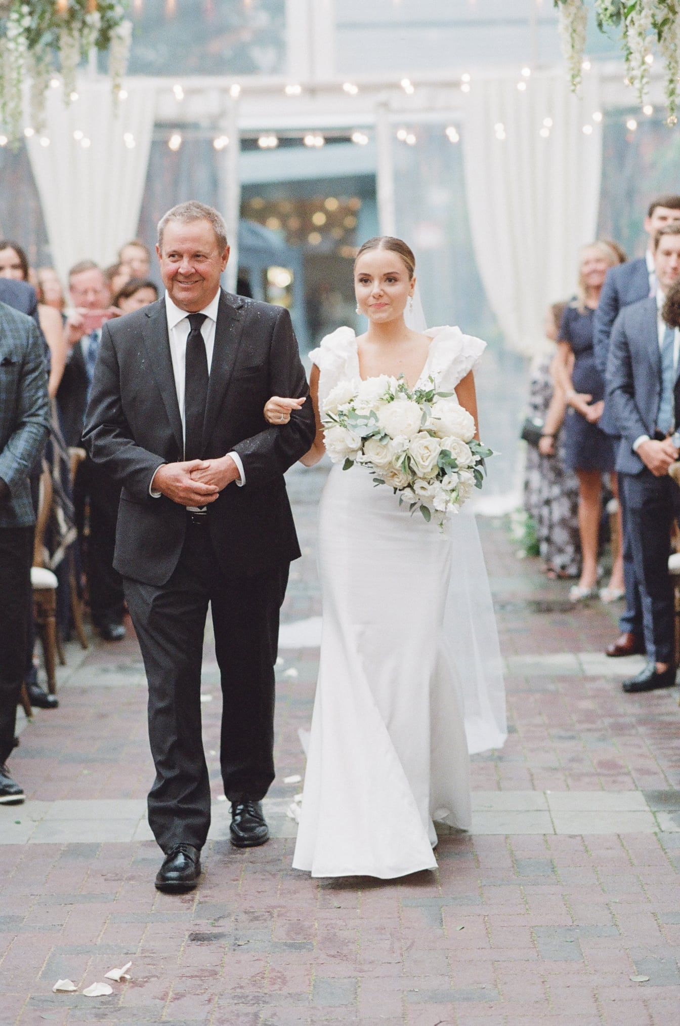 Bride and her father walking down the aisle at Chicago Illuminating Company