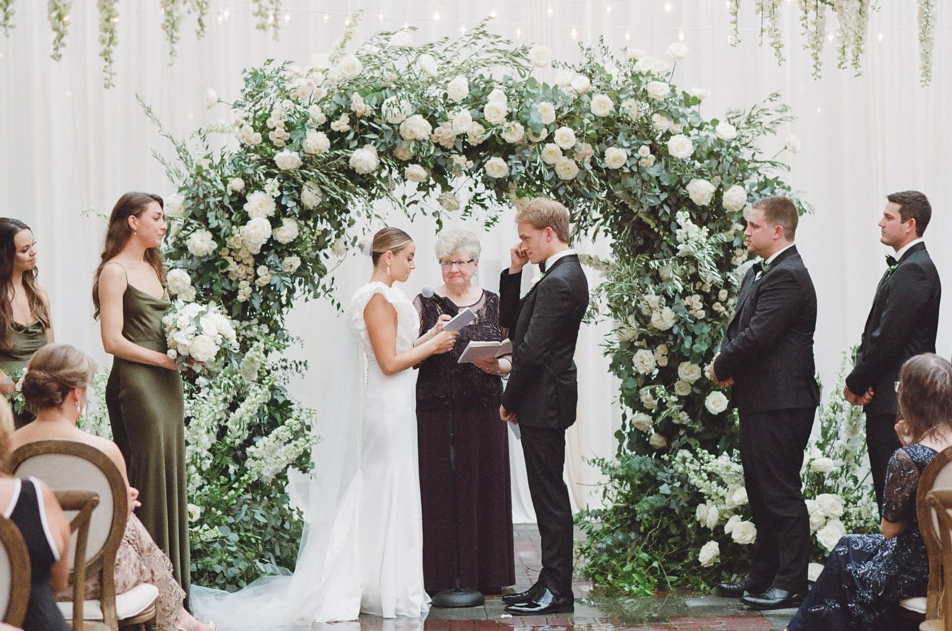 Bride reading her vow out loud to her groom