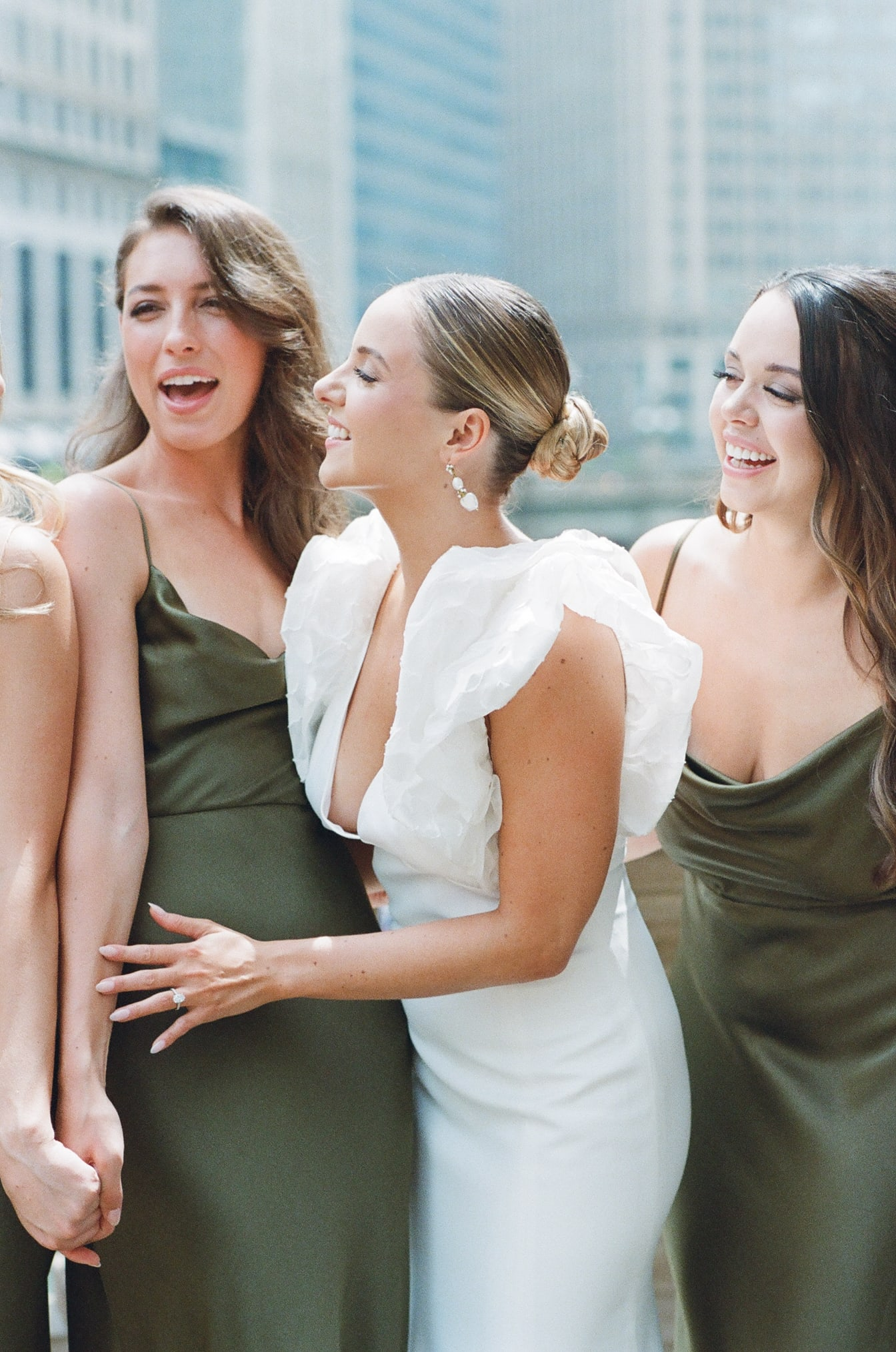 Bride laughing together with her bridesmaids in Chicago