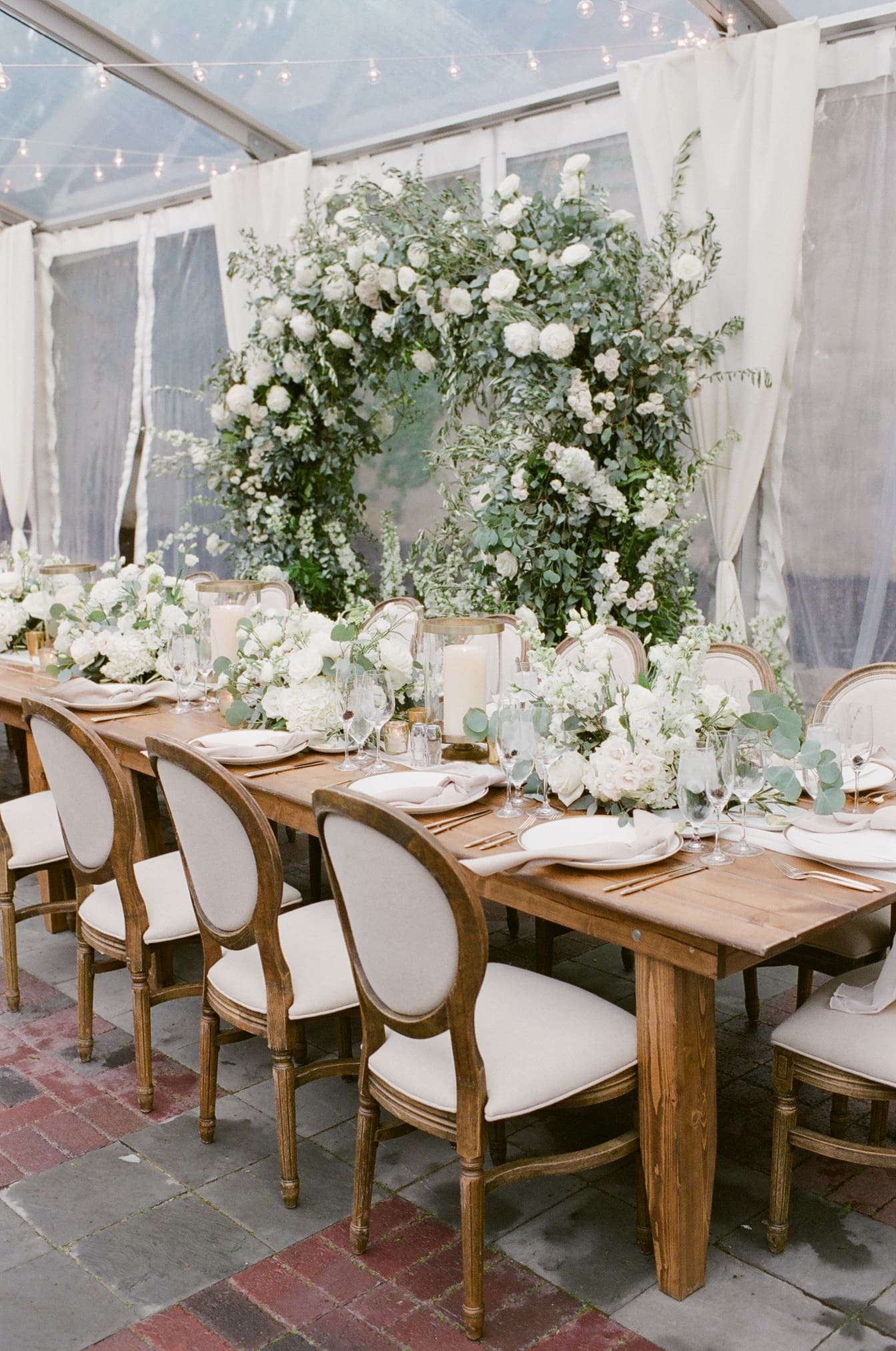 Floral arch decor in whites and greens
