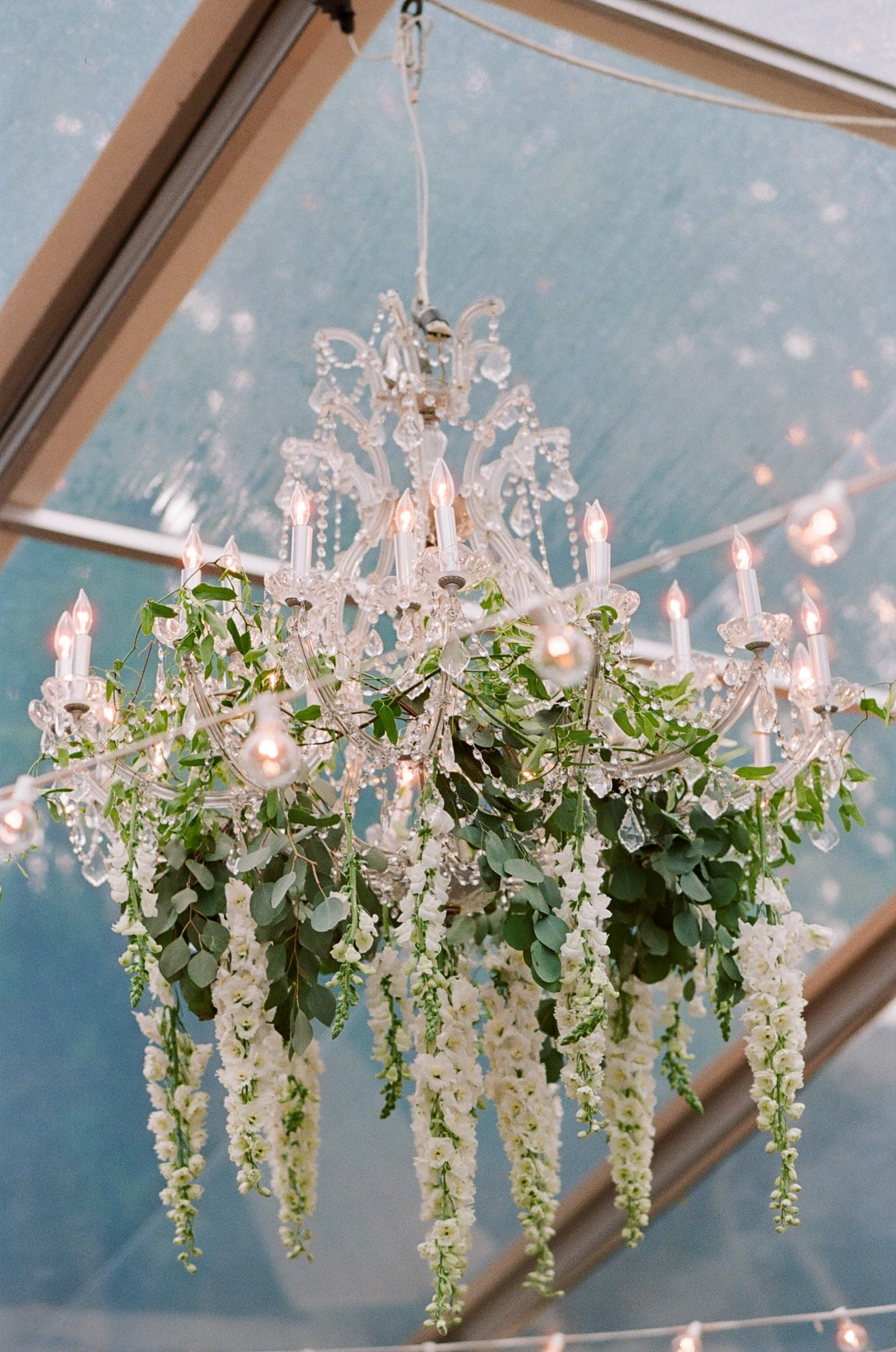 Chandelier adorned with whites and greens