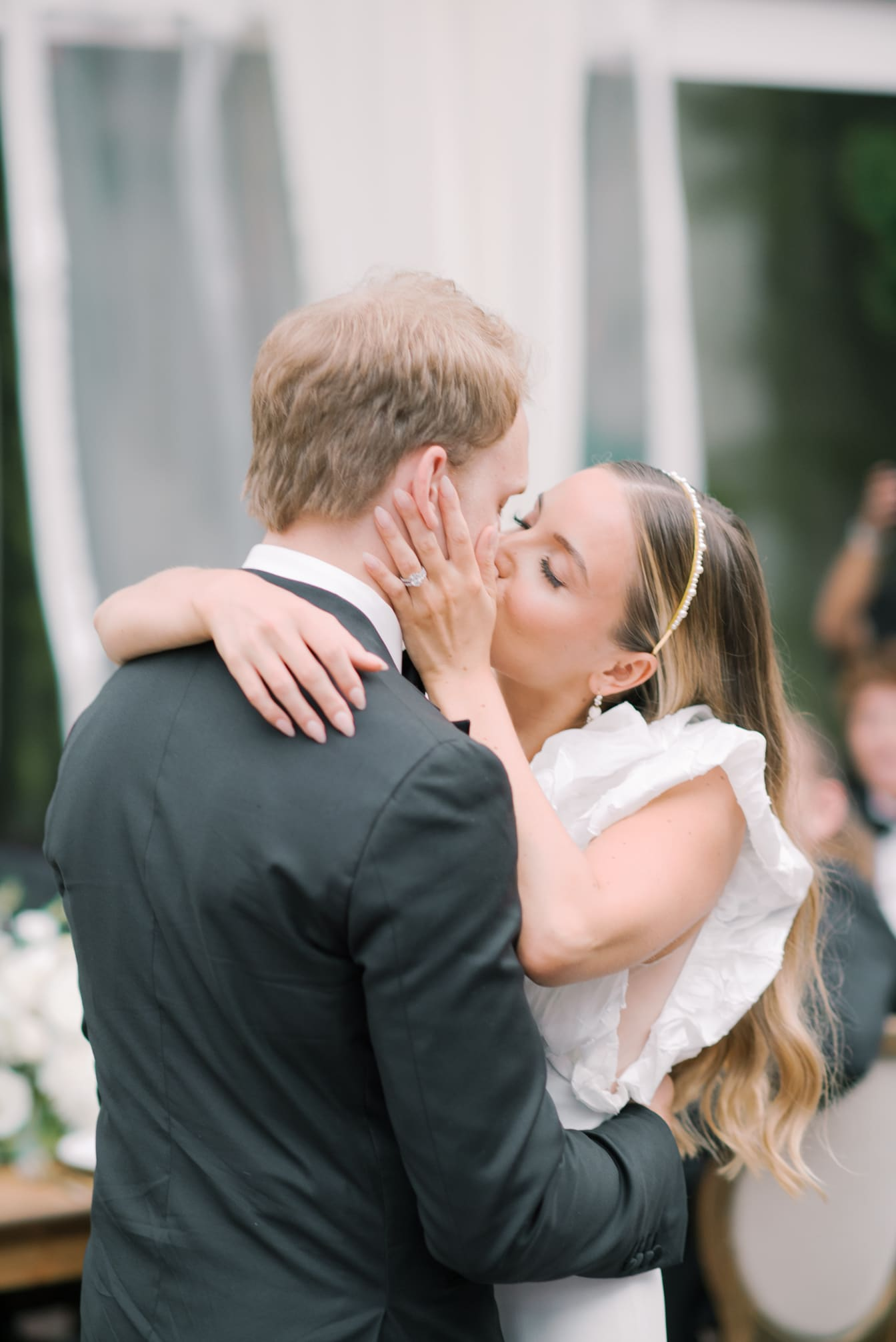 First kiss of bride and groom during first dance at Chicago Wedding