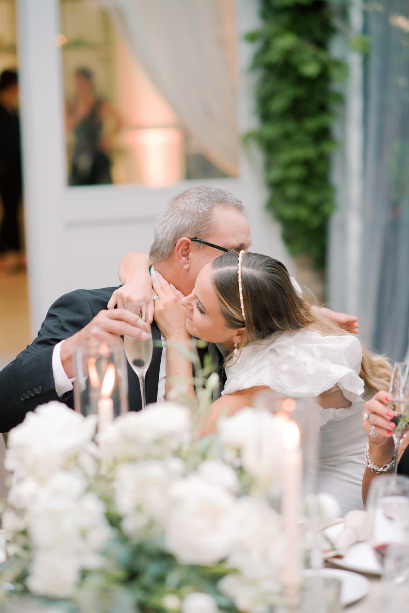 Bride embracing her dad after wedding speech