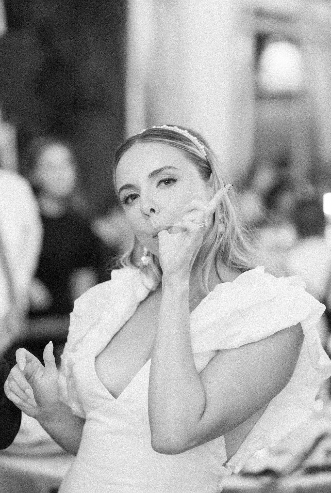 Bride eating her wedding cake