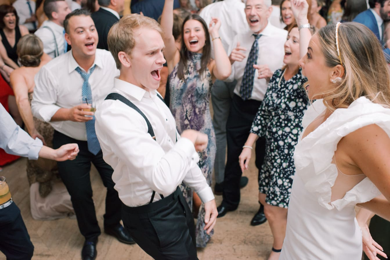 Bride and groom dancing with wedding guests at Chicago Illuminating Company