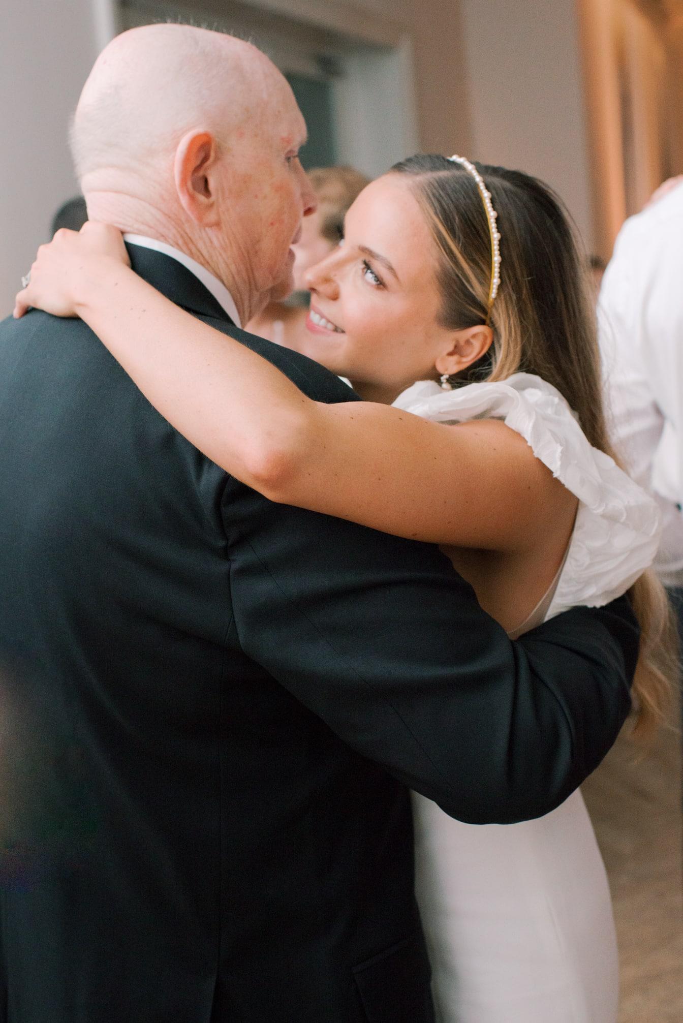Bride dancing with her grandpa