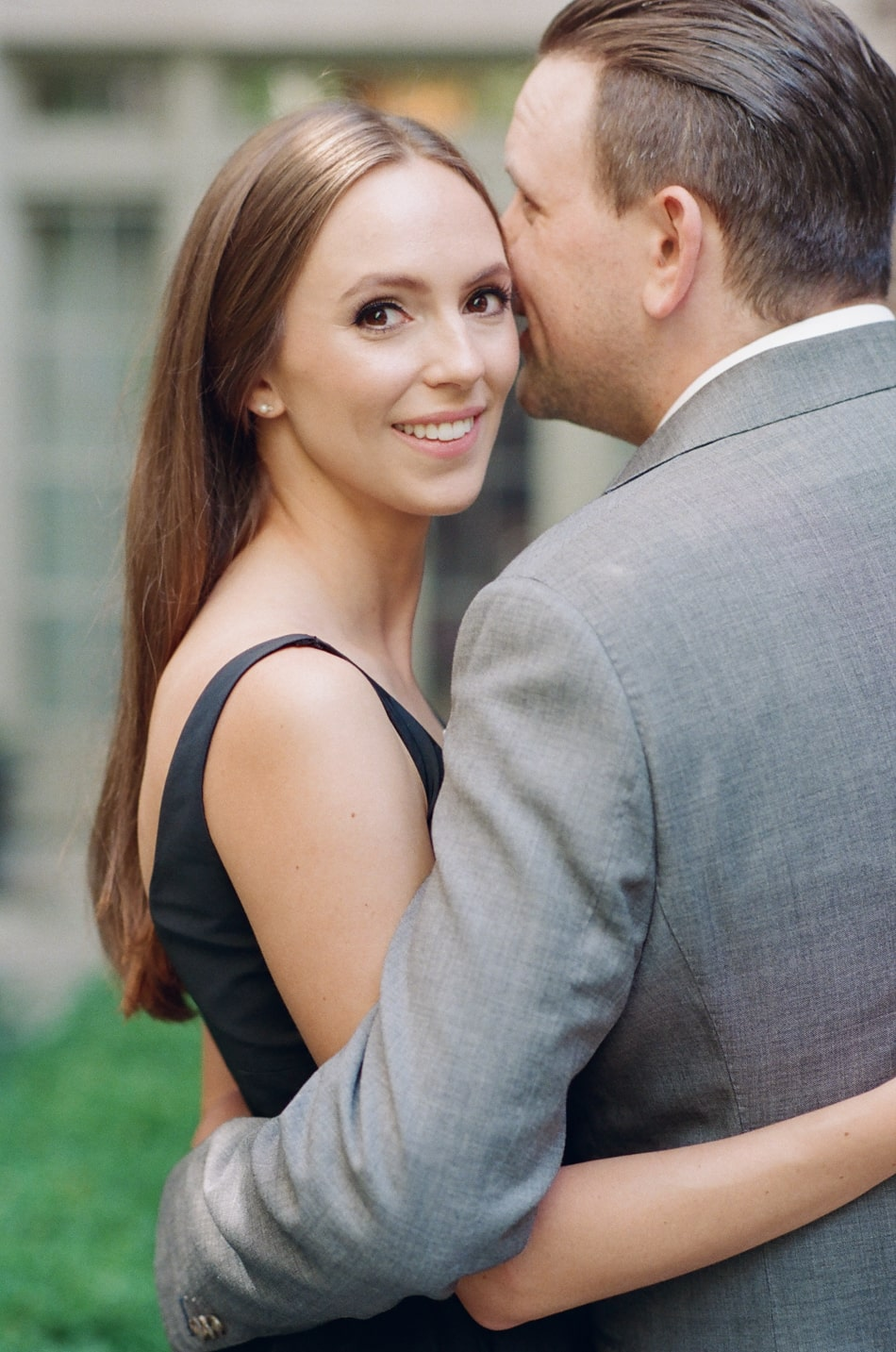 Groom kissing his bride during Chicago Engagement