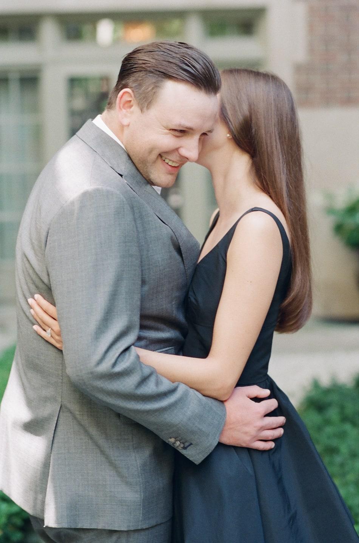 Bride whispering into groom's ears