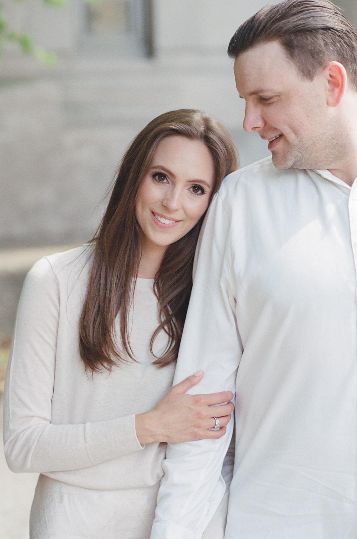 Bride leaning on her groom's shoulder in Chicago