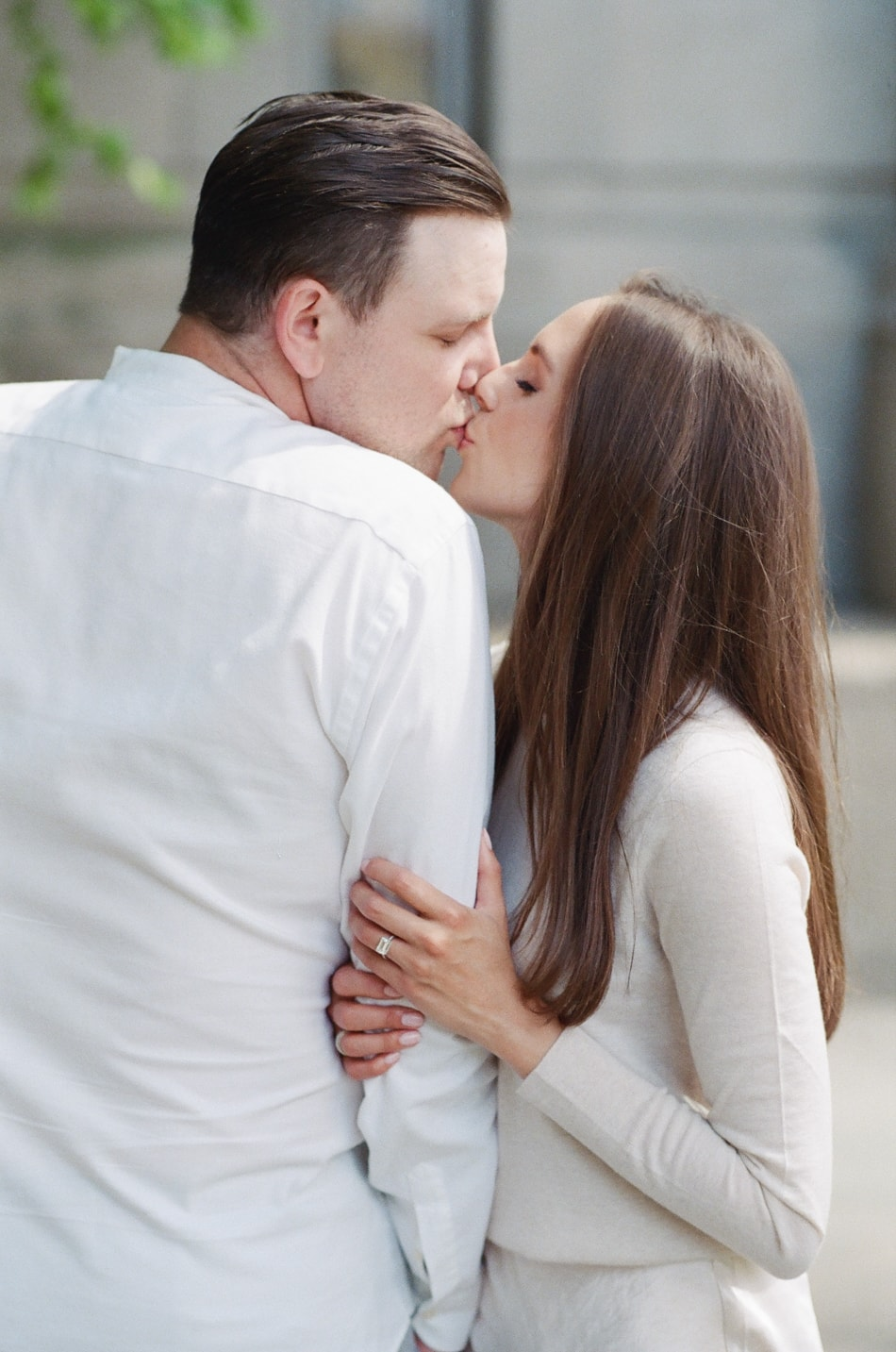 Bride and groom kissing each other at Chicago Riverwalk