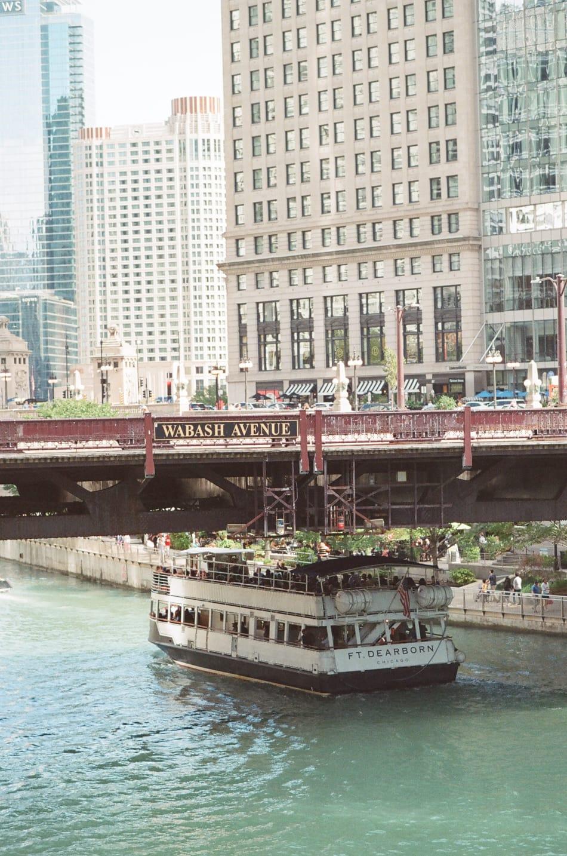 Boat crossing underneath Wabash Street Bridge in Chicago