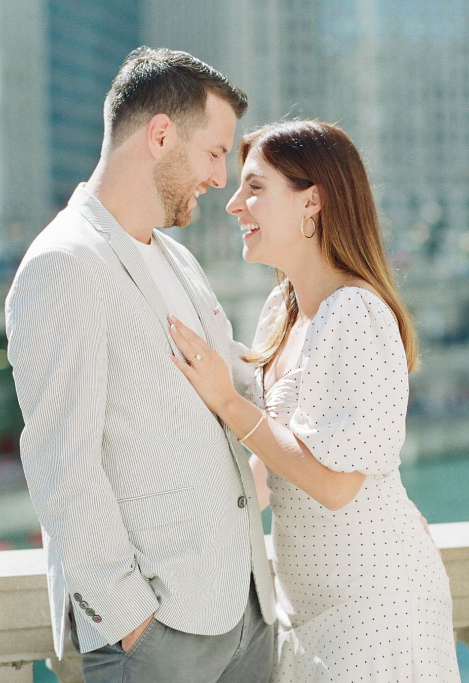 Bride and Groom laughing at each other during their Chicago engagement