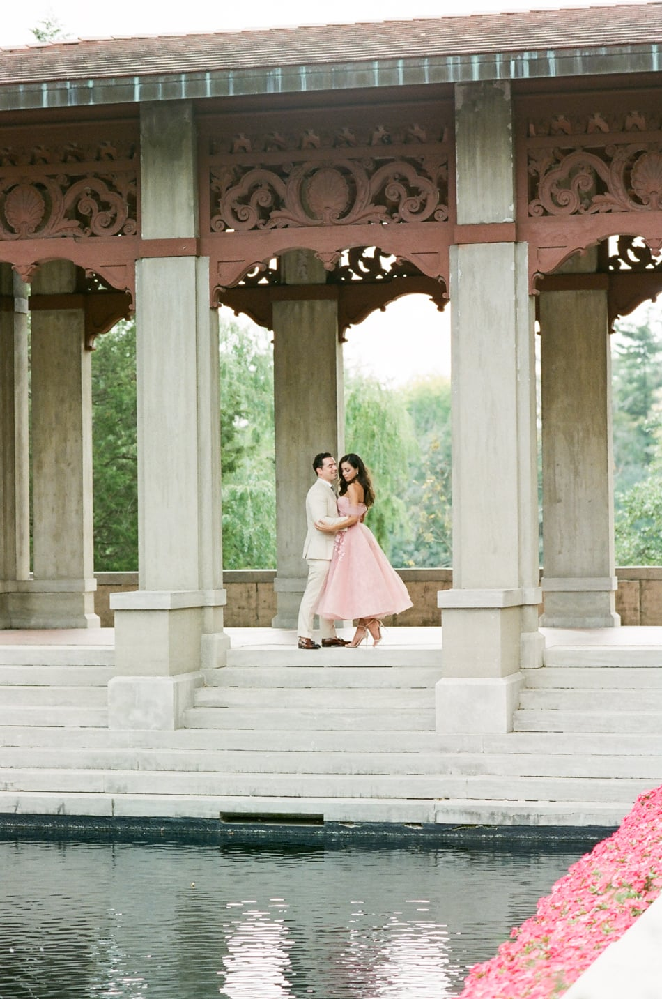 Bride and groom standing under Armour House Pavilion