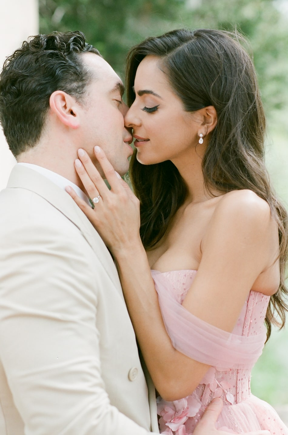 Bride and groom kissing each other