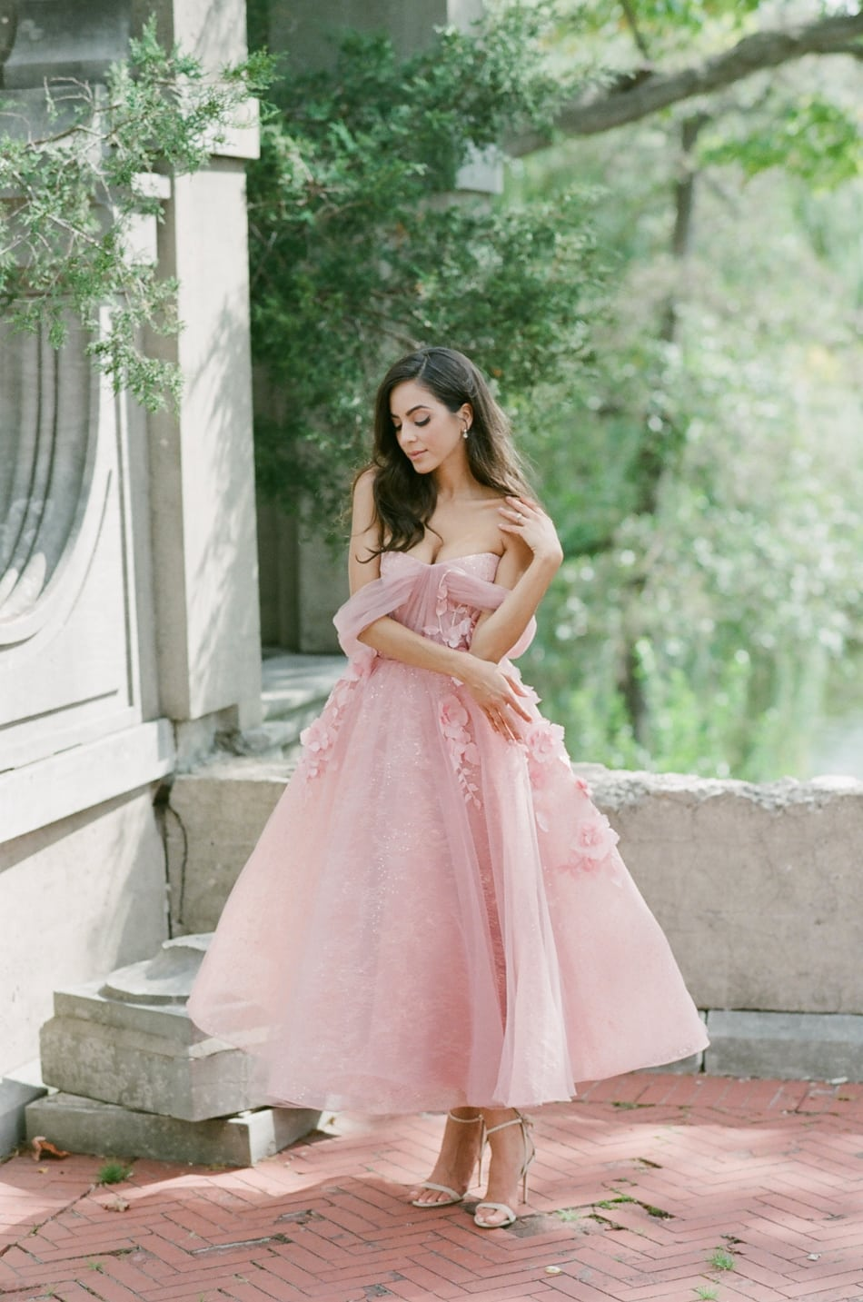 Bride wearing a blush wedding gown at her wedding in Lake Forest