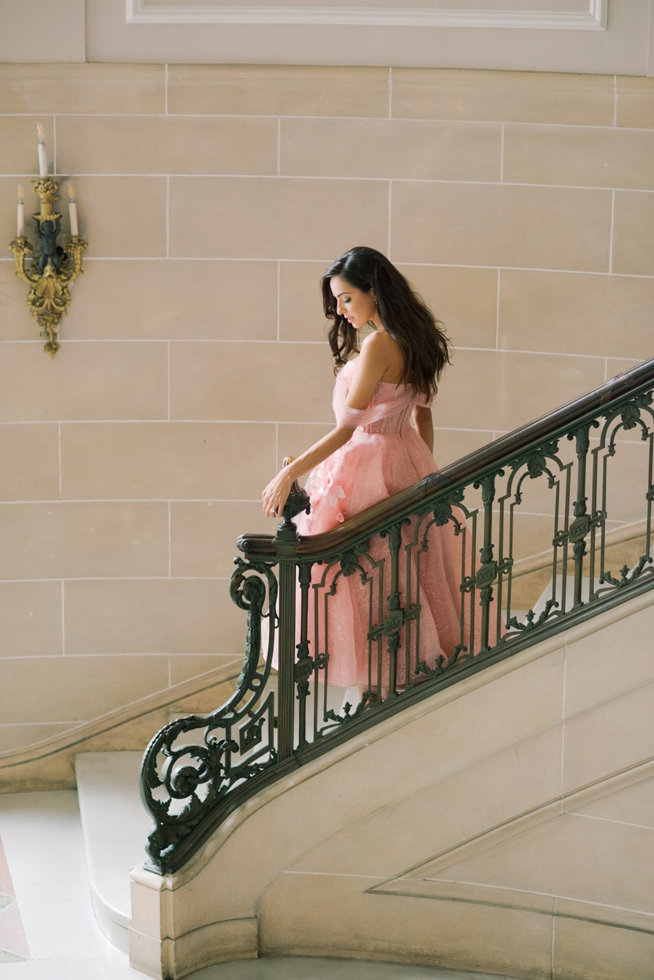 Bride in blush gown standing on stairs at Armour House